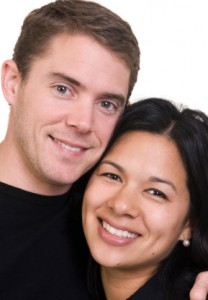 A happy Chinese - American couple.